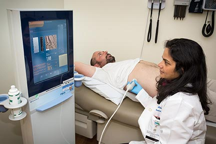Doctor using FibroScan technology to evaluate a patient.