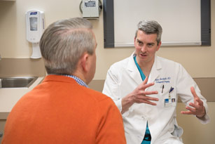 Orthopedic surgeon Kevin MacDonald, MD, with patient