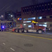 Image: 4:27 a.m.: Connector bridge, delivered by Van Dyke Trucking, arrives at Harvard via Madison and Broadway intersection.