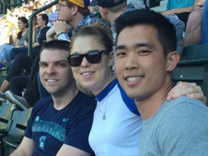 A medicine resident, a radiology resident, and an anesthesia resident at a Mariners game.