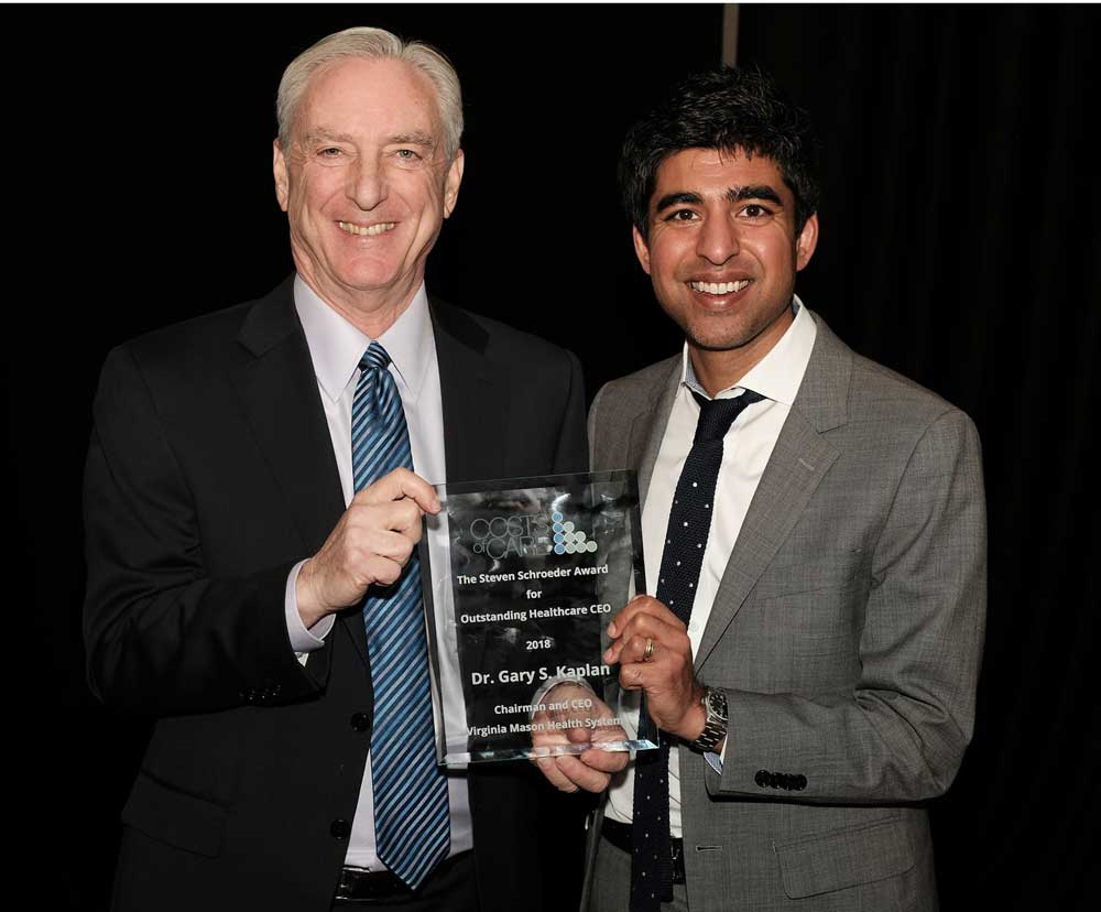 Gary S. Kaplan, MD (left) presented with the Steven Schroeder Award for Outstanding Health Care CEO by Neel Shah, MD, executive director, Costs of Care.