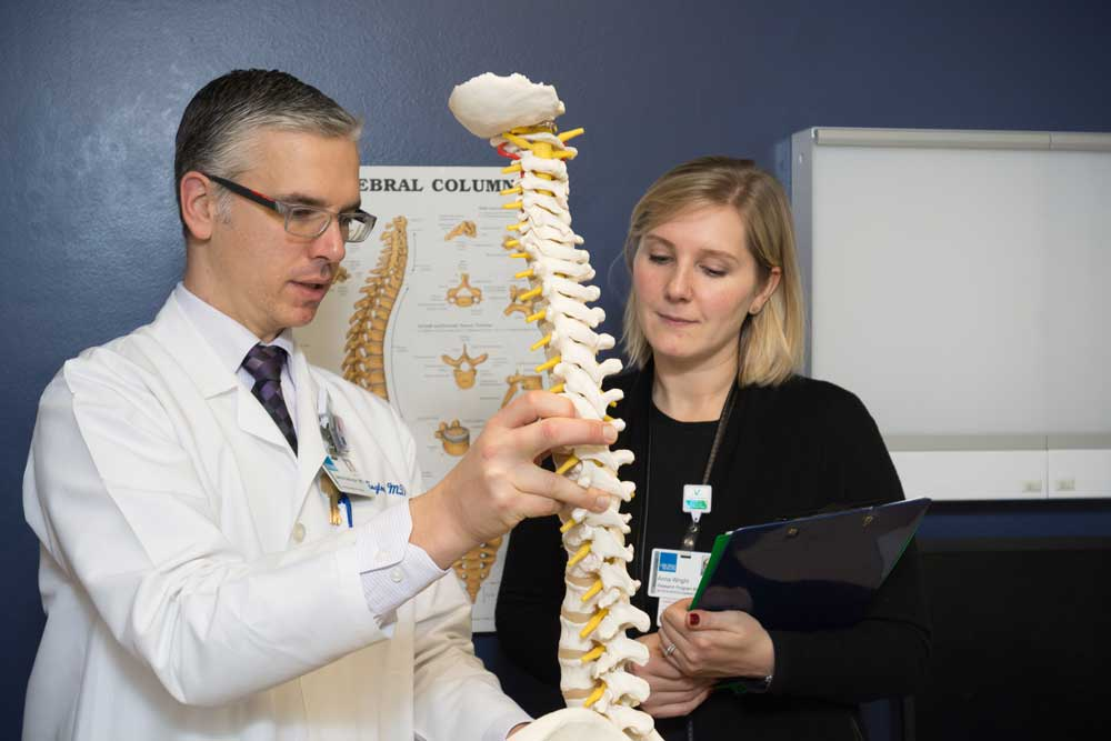 James Babington, MD, reviews common spinal pain points with Anna Wright, PhD